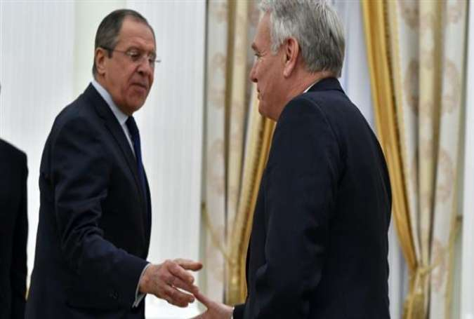Russian Foreign Minister Sergei Lavrov (L) shakes hands with French Foreign Minister Jean-Marc Ayrault prior to a meeting in Moscow, April 19, 2016.