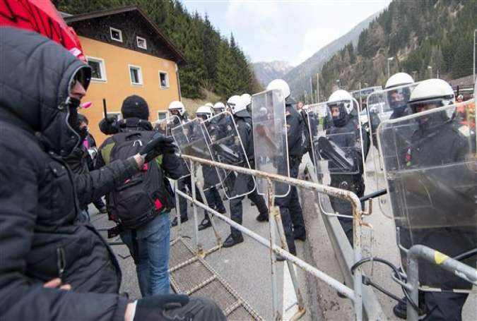 "People gathering at the border station ""Brenner"" between Austria and Italy to protest against planned border controls."