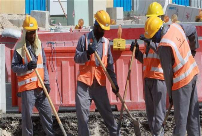 Migrant workers at a construction site in Doha, Qatar.