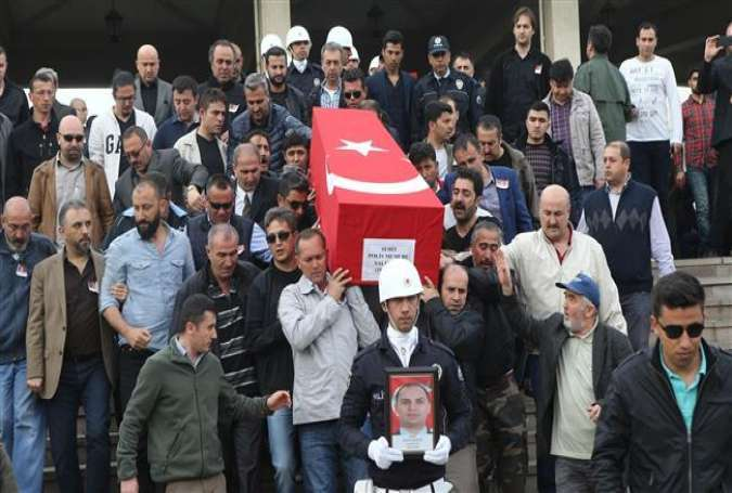 People carry the coffin of a Turkish policeman during a funeral ceremony at the Kocatepe Mosque in the capital, Ankara, on April 8, 2016.