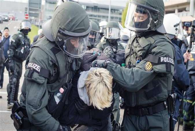 Police forces arrest a protester during a demonstration against the AfD party conference in Stuttgart, Germany, April 30, 2016.