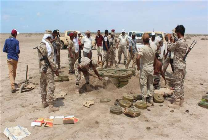 Yemeni security forces inspect unexploded ordnance confiscated from al-Qaeda militants in the Lahij Province, as they prepare to neutralize mines and explosives in the desert of al-Alam, east of the southern port city of Aden, April 29, 2016.