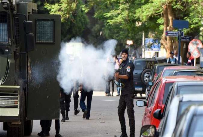 Egyptian riot police firing tear gas at protesters during an anti-government demonstration, in Cairo, April 25, 2016.