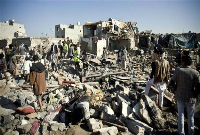 People search for survivors under the rubble of houses destroyed by Saudi airstrikes near Sana