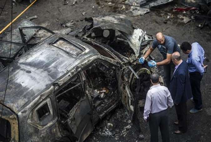 Forensic detectives gather at the site of a car bomb that targeted the convoy of the Egyptian state prosecutor, Hisham Barakat, in the capital Cairo on June 29, 2015.