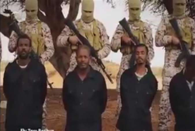 An image grab taken from a video reportedly released by the Daesh Takfiri terrorist group on May 11, 2016, shows men described as Ethiopian Christians kneeling on the ground in front of masked terrorists on a beach at an undisclosed location in Libya.