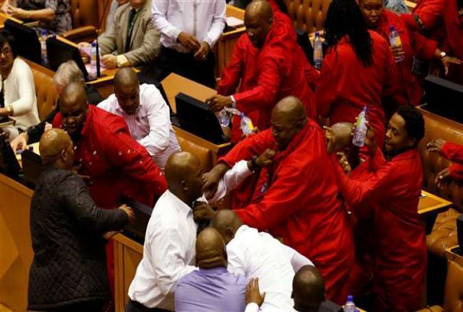 Party leader Julius Malema and members of his Economic Freedom Fighters (EFF) clash with parliamentary security as they are evicted from the chamber in Cape Town, South Africa, May 17, 2016.