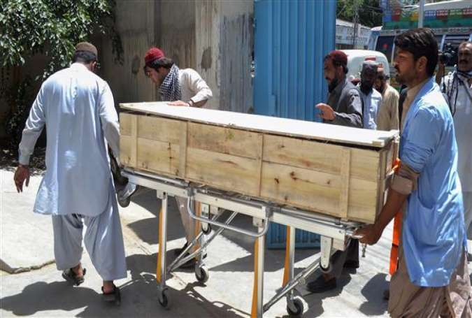 Pakistani security officials and hospital staff move a dead body into a morgue in Quetta on May 22, 2016 following a drone strike in the remote town of Ahmad Wal in Balochistan that targeted Afghan Taliban Chief Mullah Akhtar Mansour.