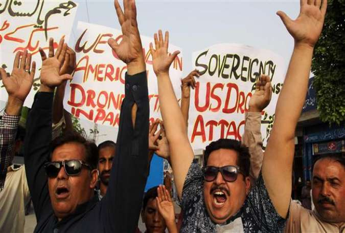 Pakistani civil society activists shout slogans during a demonstration in Multan on May 23, 2016, against a US drone strike in Pakistan