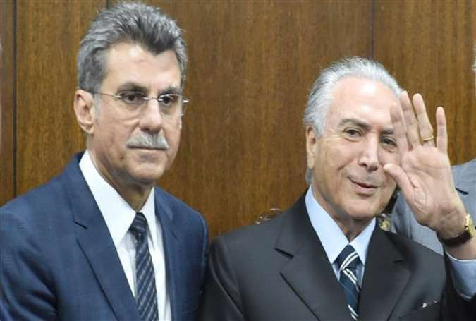 Brazil's acting President Michel Temer (R) and his Planning Minister Romero Juca