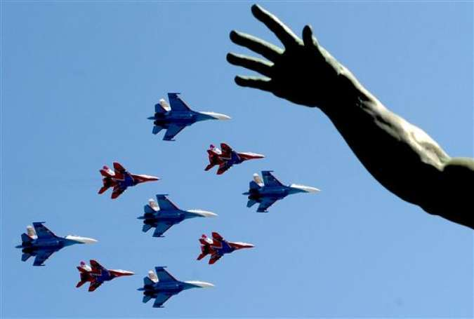Russian Su-27 jet fighters and MIG 29 jet fighters fly over Red Square during the Victory Day military parade in Moscow on May 9, 2016.