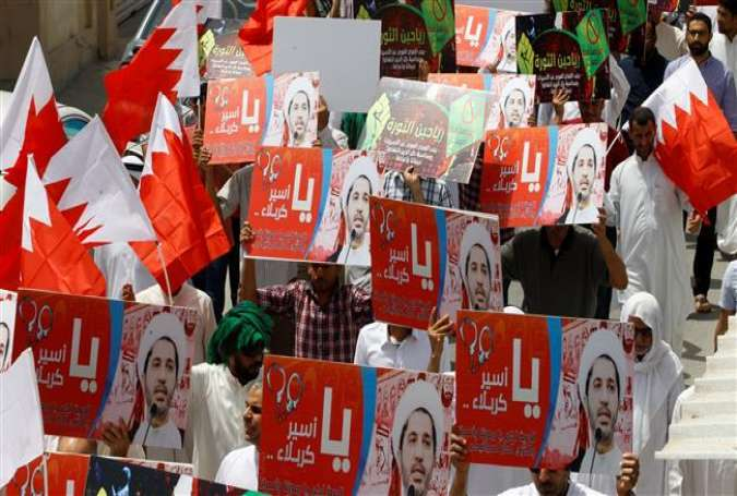 Protesters hold banners with photos of opposition leader and secretary general of the al-Wefaq National Islamic Society Sheikh Ali Salman during a protest after Friday prayers in the village of Diraz, Bahrain, on May 13, 2016.