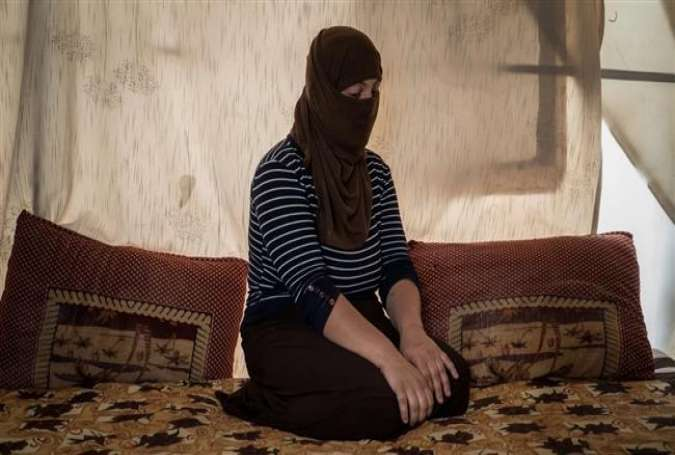 Daesh militant Abu Assad Almani posted the photo of an Izadi woman on his Facebook page and wrote