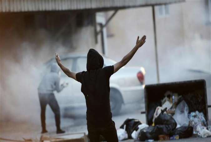 A Bahraini protester shouts slogans during clashes with riot police in the village of Sitra, south of the capital, Manama, February 12, 2015.