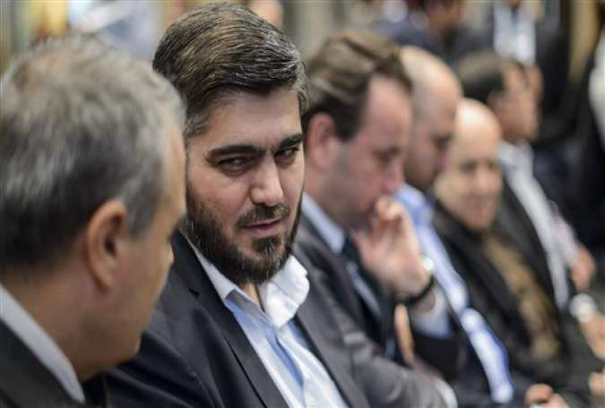 Chief negotiator for Syria's Saudi-backed opposition group (HNC), Mohammed Alloush (2nd L) speaks with the HNC delegation head prior to a press conference in Geneva on April 19, 2016.