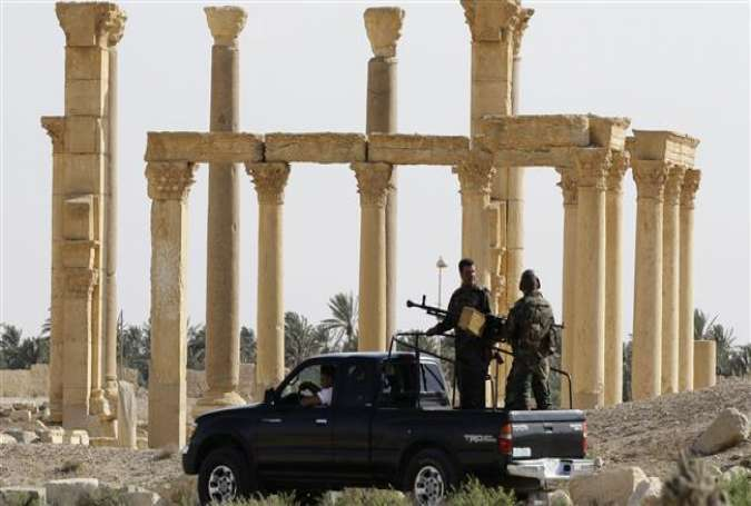 Members of the Syrian army patrol the ancient Syrian city of Palmyra, May 6, 2016.