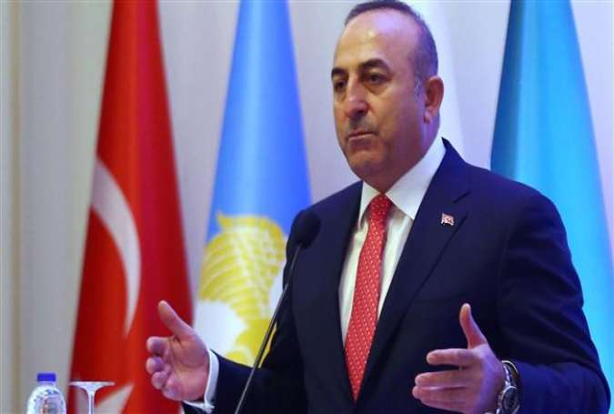 Turkish Foreign Minister Mevlut Cavusoglu addresses the Syrian Turkmen Assembly meeting in Ankara, May 26, 2016.