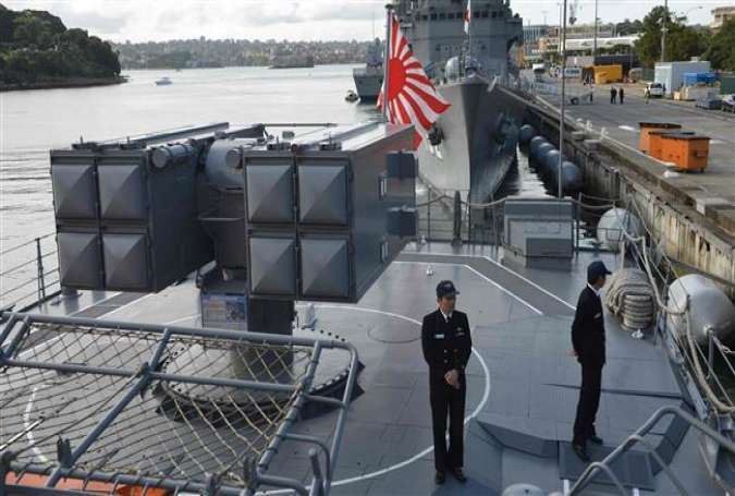 Japanese sailors are seen on the deck of the Japanese Asagiri-class destroyer, JDS Umigiri docked in Sydney