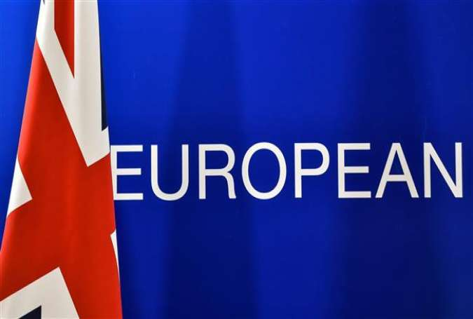 "A British flag is seen next to the word ""European"", during a press conference of British Prime minister on June 28, 2016 in Brussels."