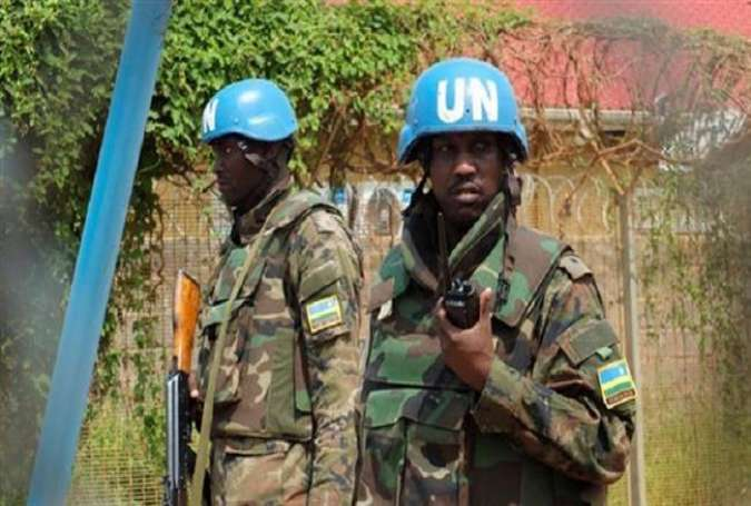 Rwandan peacekeepers serving in the United Nations Mission in South Sudan (UNMISS) stand guard inside their compound in Juba on July 20, 2016.
