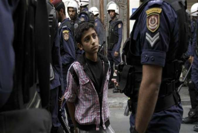 Bahraini riot police arrest a boy during anti-government protests in the capital of Manama in 2013.