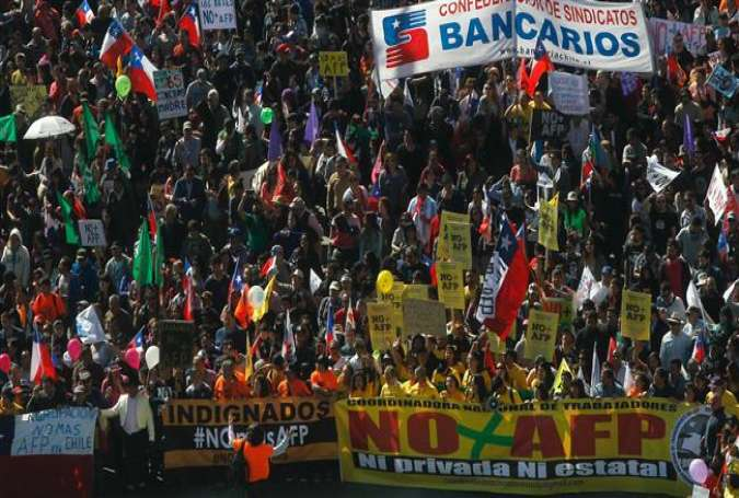 Thousands of workers march to protest against the Pension Fund Administrator (AFP) in Santiago, on August 21, 2016.