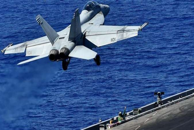 An F-18 takes off from the US Navy