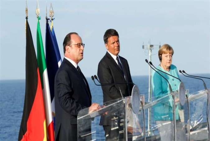 From Left: French President Francois Hollande, Italian Prime Minister Matteo Renzi and German Chancellor Angela Merkel on an Italian aircraft carrier on August 22, 2016.