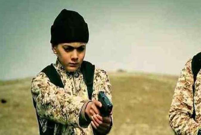 A frame grab shows a youngster carrying out an execution for Daesh.