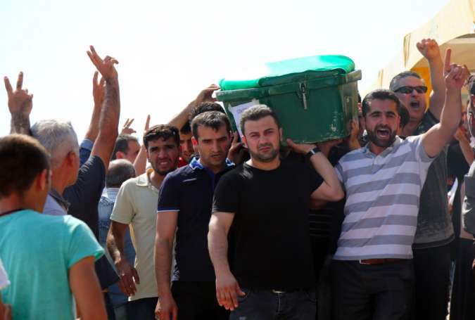 People carry coffins during a funeral for victims of a terrorist attack on a wedding party that left at least 30 dead in Gaziantep near the Syrian border on August 21, 2016.