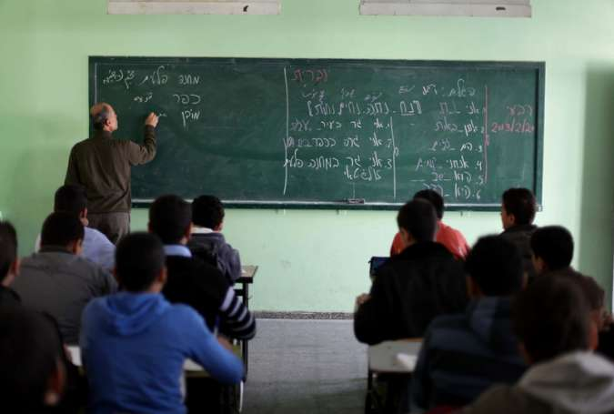 Ninth-grade students learn Hebrew at a Gaza City school