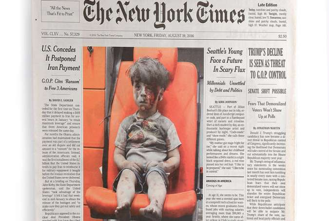 Behind the photograph of Omran Daqneesh
