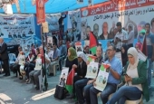 Palestinians stage a sit-in outside the International Committee of the Red Cross (ICRC) office in the West Bank city of al-Bireh on September 7, 2016.