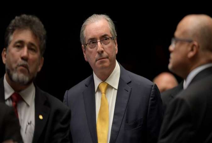 Brazil's former house speaker, Eduardo Cunha (center), is seen during a Chamber of Deputies session in Brasilia on September 12, 2016.