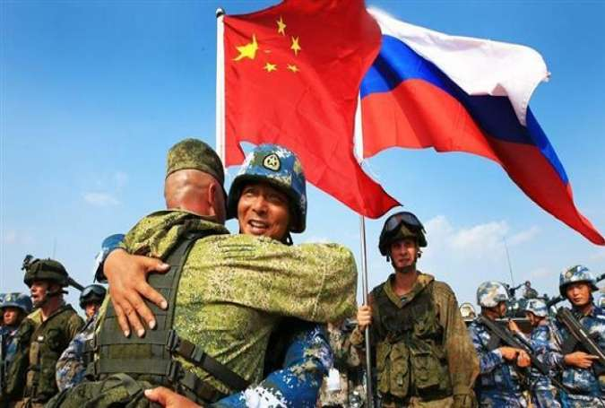 Russia, China continue joint drill in disputed sea