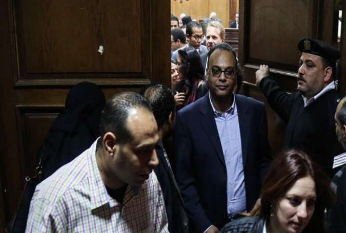 Investigative journalist Hossam Baghat (C) leaves a courtroom at Cairo Criminal Court in Cairo, Egypt, March 24, 2016.