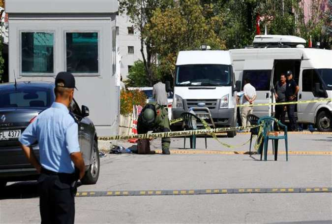 A bomb disposal expert examines a bag in front of the Israeli embassy in Ankara on September 21, 2016.
