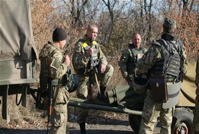 Ukrainian servicemen stand at a government-controlled position on the front line of the conflict with pro-Russia forces in Donetsk, November 7, 2015.