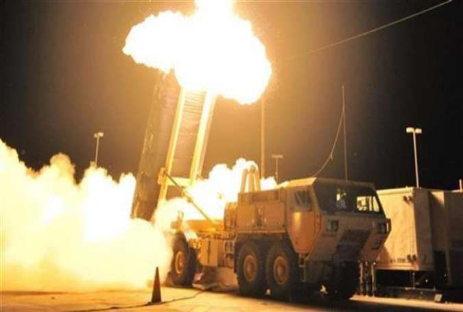 The file photo shows a test of the Terminal High Altitude Area Defense (THAAD) missile system in Hawaii.