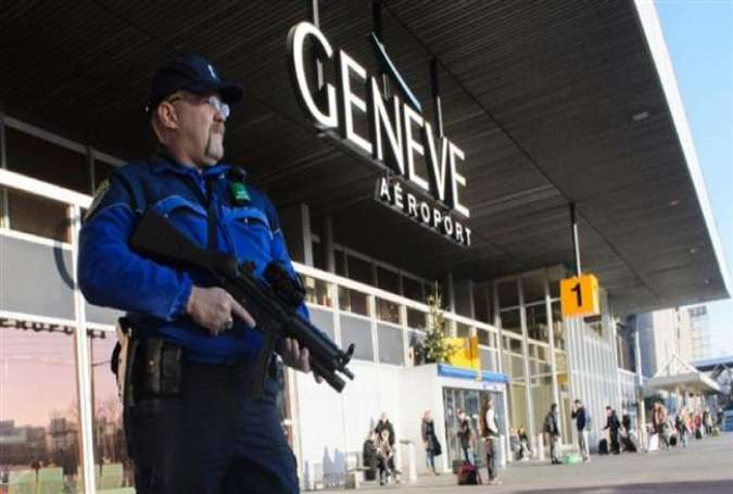 An armed policeman patrols at the Geneva Airport in Geneva, Switzerland, December 12, 2015.
