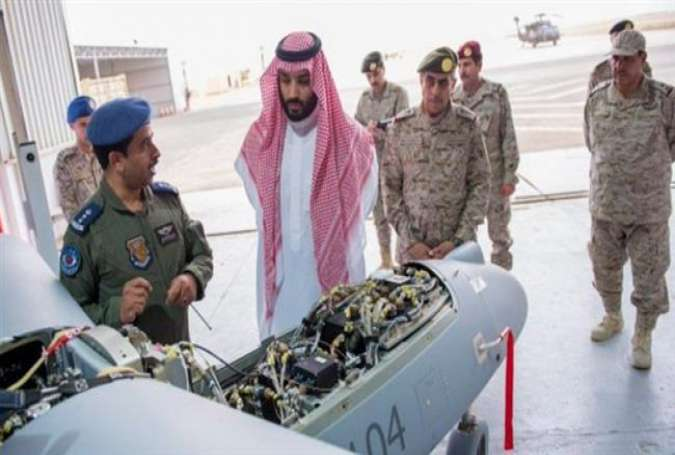The undated picture by Saudi Press Agency shows Saudi Defense Minister Prince Mohammed bin Salman inspecting a drone during visit to forces in the kingdom's northern border.