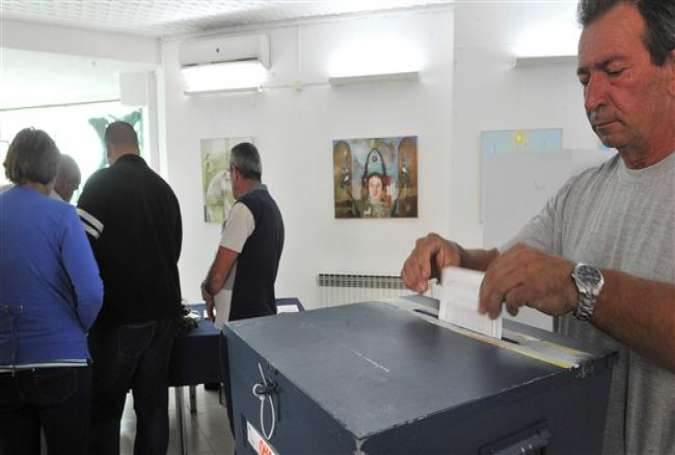 "A man votes during a referendum on ""Statehood Day"" in the town of Laktasi in Bosnia and Herzegovina, September 25, 2016."