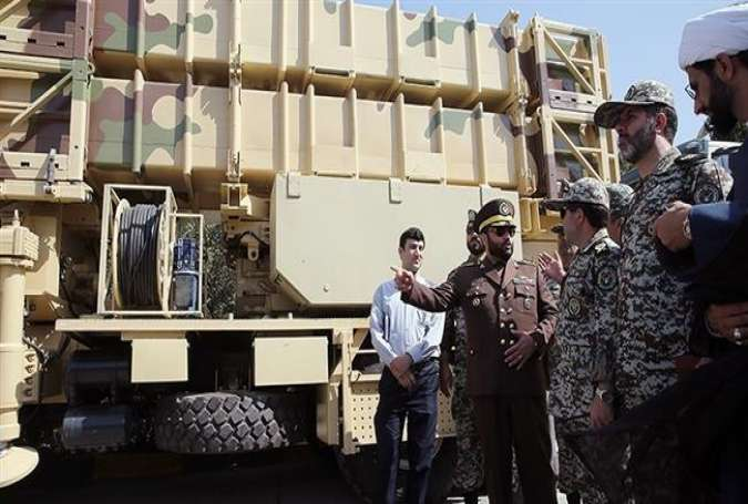 In this file photo, Brigadier General Farzad Esmaili, the commander of Khatam al-Anbia Air Defense Base, gestures while speaking beside the fully-indigenous Talaash (Endeavor) air defense missile system.