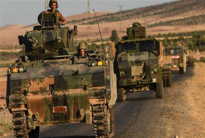 Turkish soldiers stand in an army tank driving back to Turkey from the Syrian border town of Jarablus on September 2, 2016.