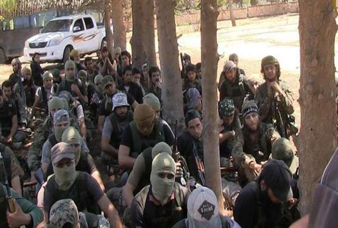 This file photo shows members of the Takfiri Jabhat Fateh al-Sham militant group, formerly known as al-Nusra Front, in an undisclosed location in Syria.