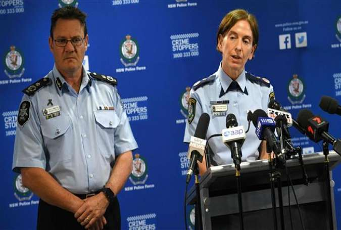 New South Wales Police Commissioner Catherine Burn (R) and Australian Federal Police Deputy Commissioner Michael Phelan address the media after two 16-year-old boys were charged with terror-related offenses in Sydney on October 13, 2016.