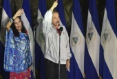 Nicaraguan President Daniel Ortega (R) and his wife Rosario Murillo wave after voting in the capital, Managua, during the presidential election on November 6, 2016.