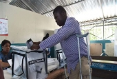 A voter casts his ballot at a polling station at the Lycee National of Petion Ville in the Haitian capital Port-au-Prince, on November 20, 2016 during the presidential and legislative elections.