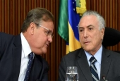 The photo taken on June 15, 2016, shows Brazilian President Michel Temer, right, and General Secretary of the Brazilian Presidency Geddel Vieira Lima speaking during a meeting with party leaders of the National Congress at Planalto Palace in Brasilia.