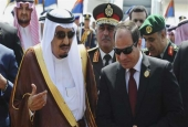 In this March 28, 2015 file photo, Egyptian President Abdel Fattah el-Sisi, right, talks with Saudi King Salman in Sharm el-Sheikh.
